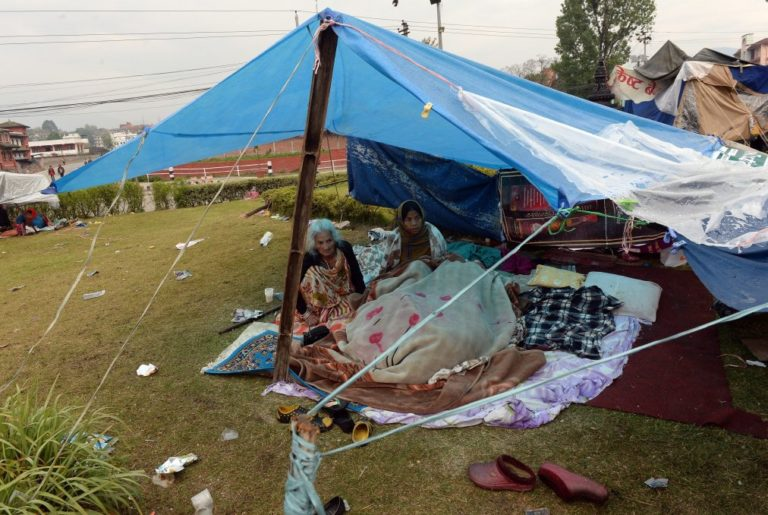 Nepalese people rest in their makeshift shelter next to a road in Kathmandu on April 27, 2015, two days after a 7.8 magnitude earthquake hit Nepal. International aid groups and governments intensified efforts to get rescuers and supplies into earthquake-hit Nepal on April 26, but severed communications and landslides in the Himalayan nation posed formidable challenges to the relief effort. AFP PHOTO / PRAKASH SINGH (Photo credit should read PRAKASH SINGH/AFP/Getty Images)