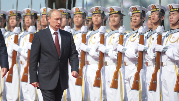 Russia's President Vladimir Putin, centre, and China's President Xi Jinping left, walk to open joint naval exercises in Shanghai, China, Tuesday, May 20, 2014. (AP Photo/RIA Novosti, Alexei Druzhinin, Presidential Press Service)