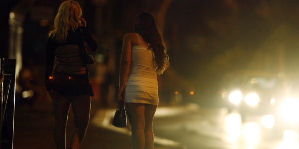 ** ADVANCE FOR MONDAY, SEPT. 10 ** Prostitutes are seen in Rome in this July 3, 2007 photo. Italian law gives foreign prostitutes a chance to escape human traffickers who force young women from poor countries to sell their bodies to pay for their passage into Western Europe. While some other European nations also have laws to help trafficked prostitutes, Italy's legislation stands out because of its elasticity: Women are encouraged, but not required, to testify against their traffickers. (AP Photo/Andrew Medichini)